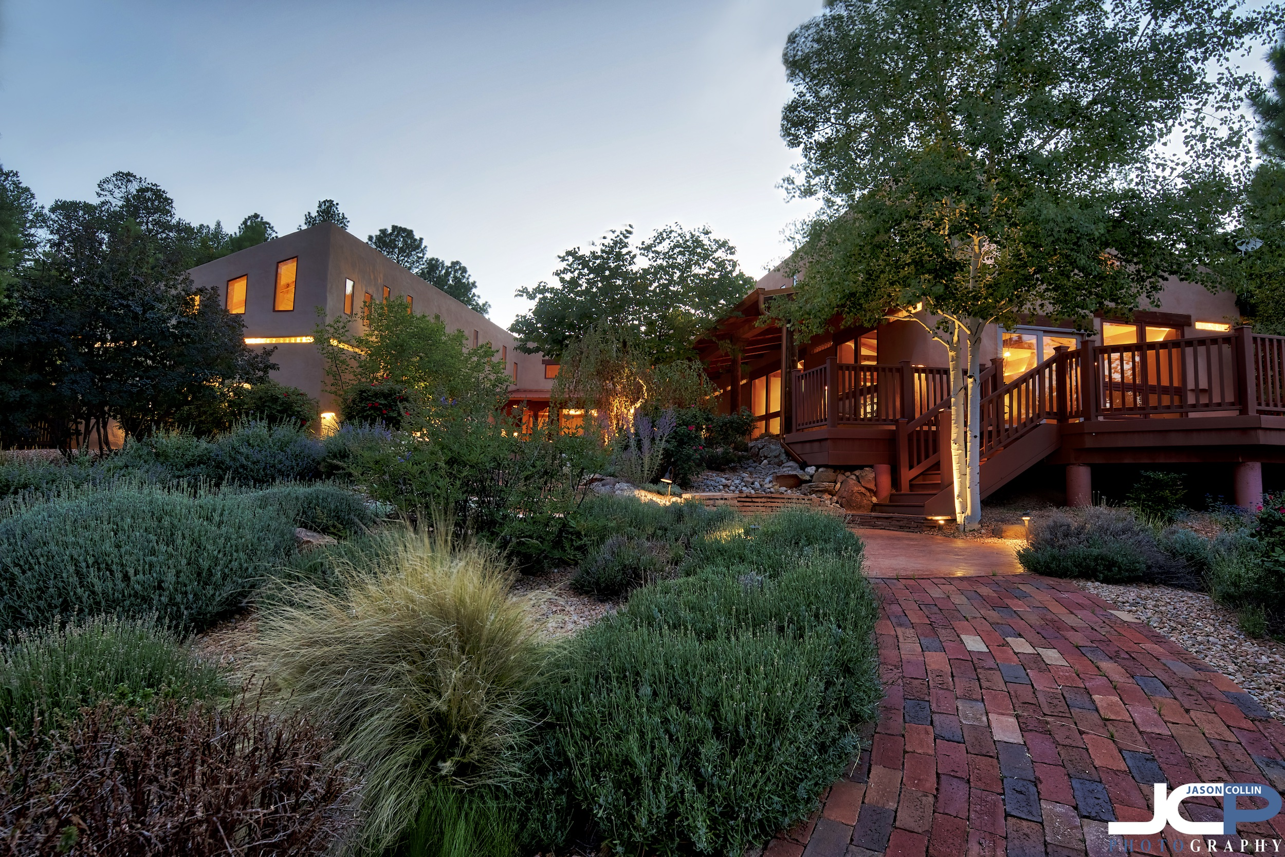 Twilight view of a luxury real estate property in Sandia Crest, New Mexico