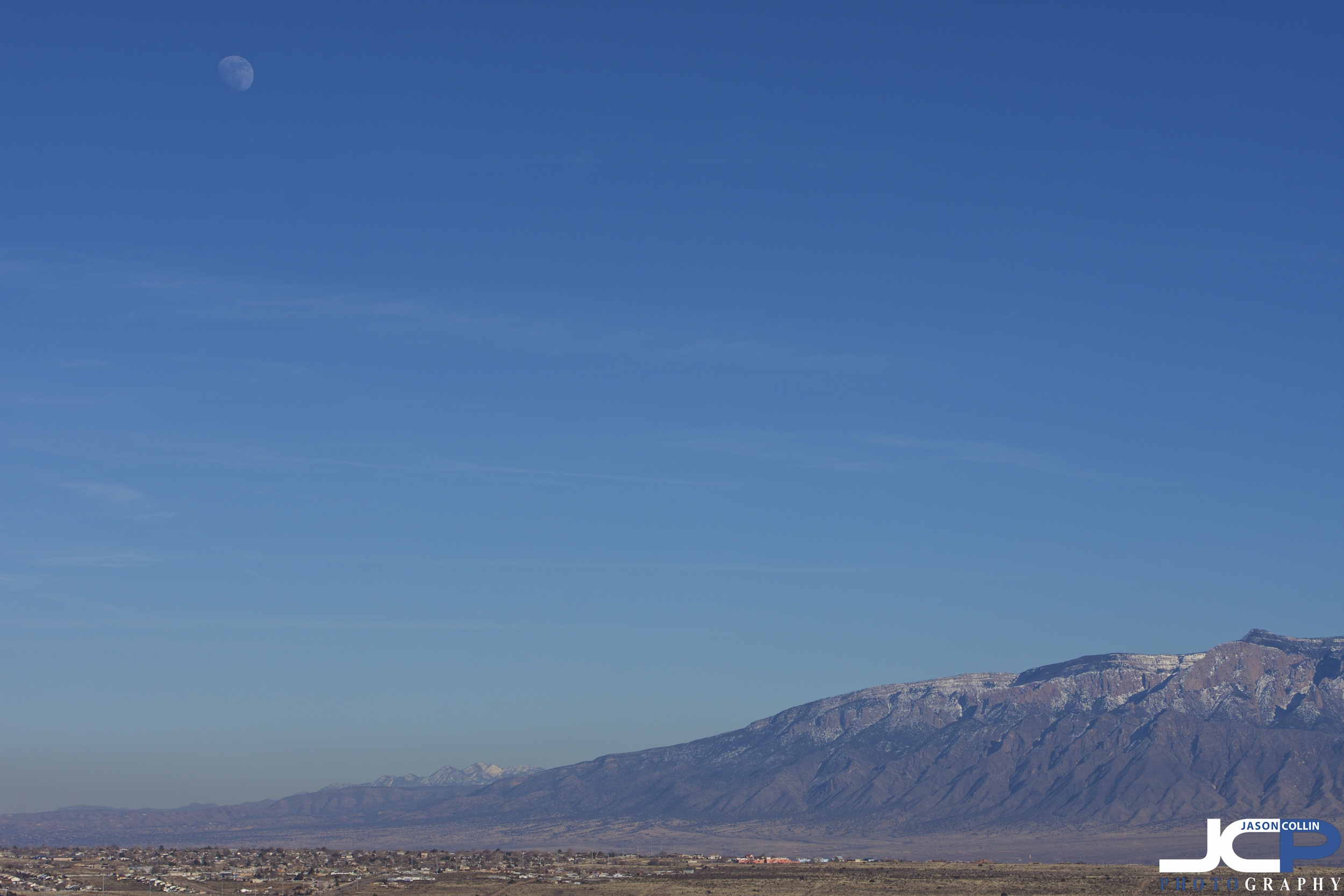 The edges of Albuquerque metro area with the Sandias and the Moon - New Mexico fine art photography