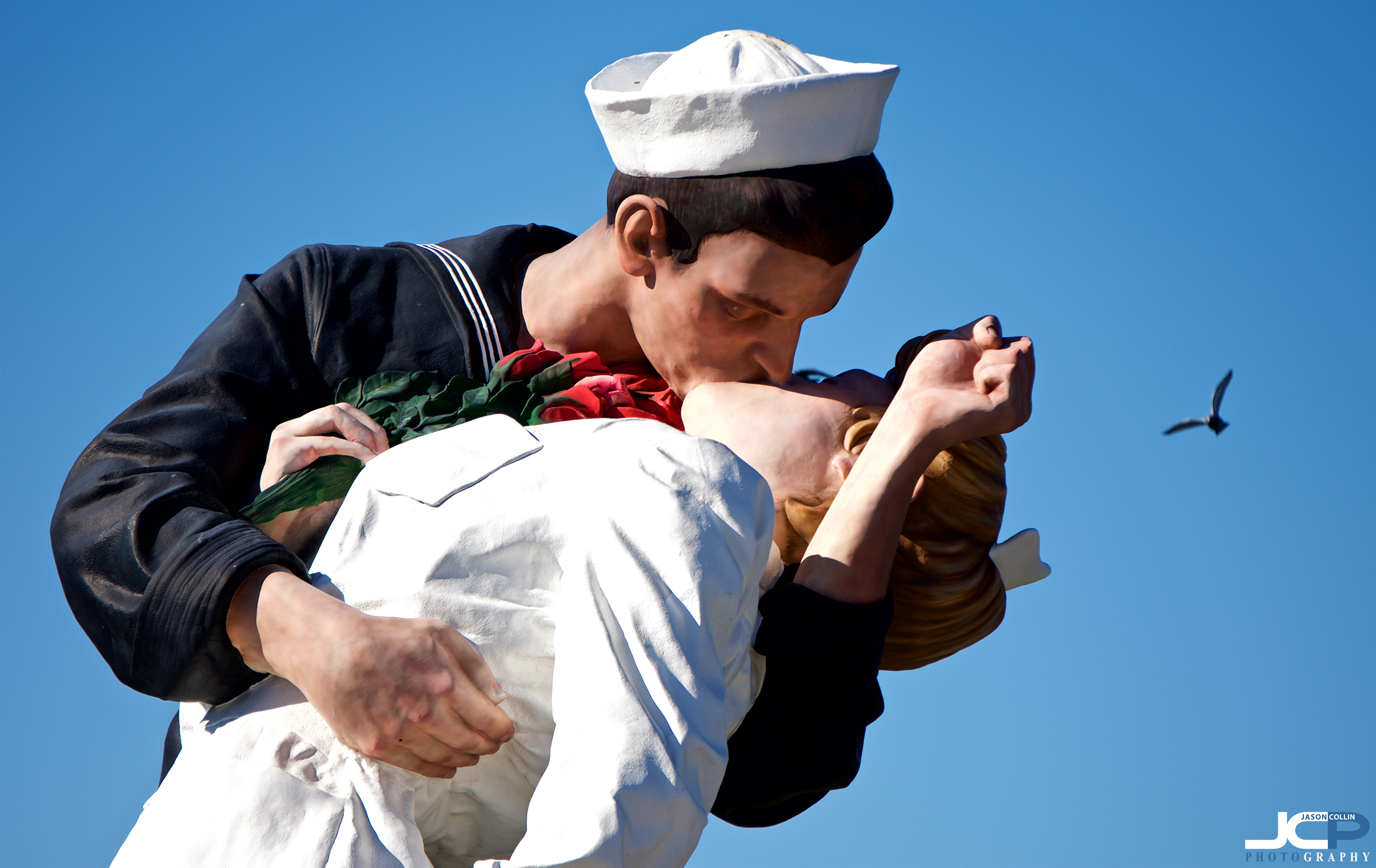 sailor kissing woman stature san diego