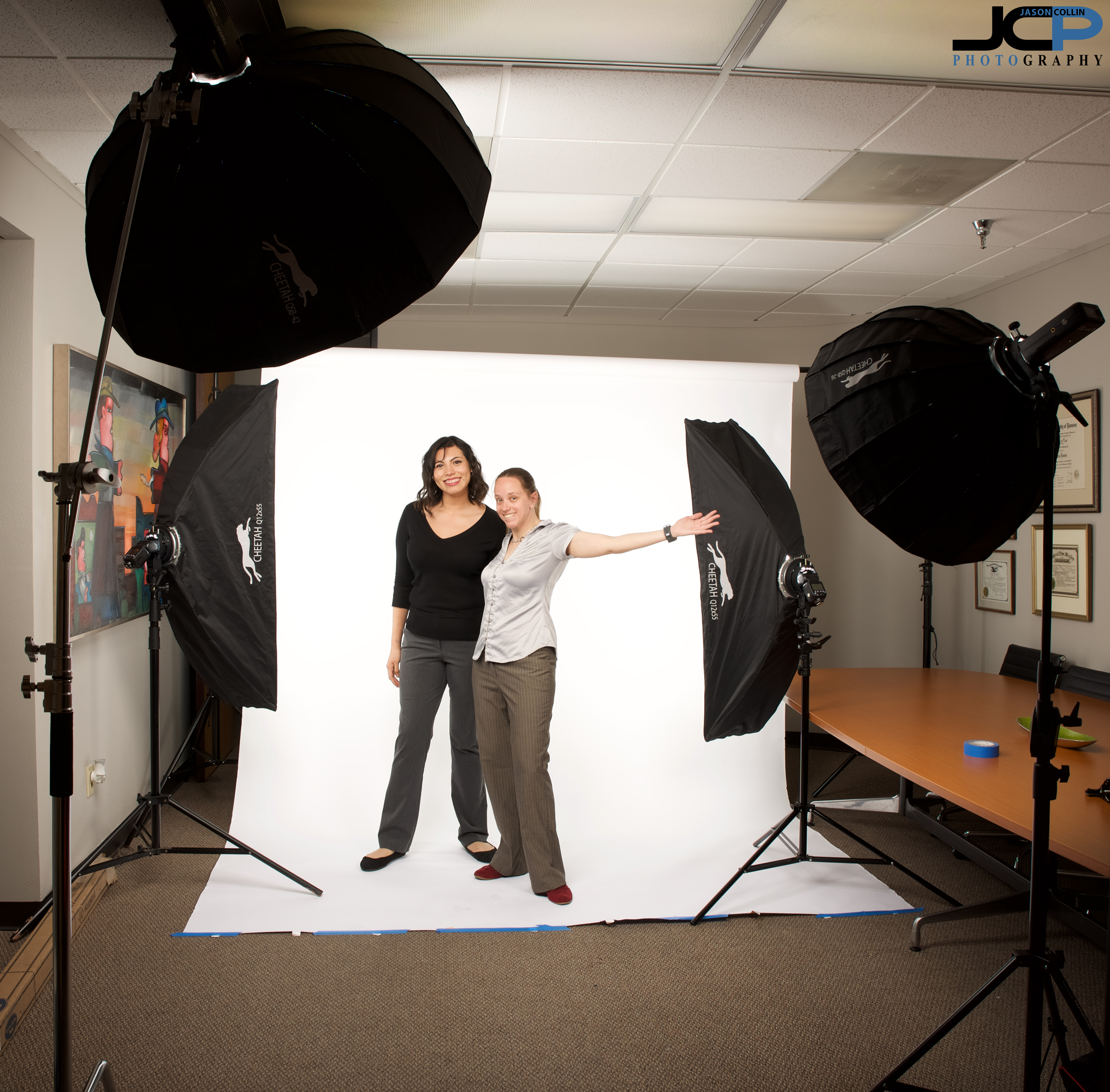 "The setup used to make professional head to toe headshots - 42"" main light, 26"" fill light, and two 12""x55"" strip boxes on the white paper background to make it truly seamless."