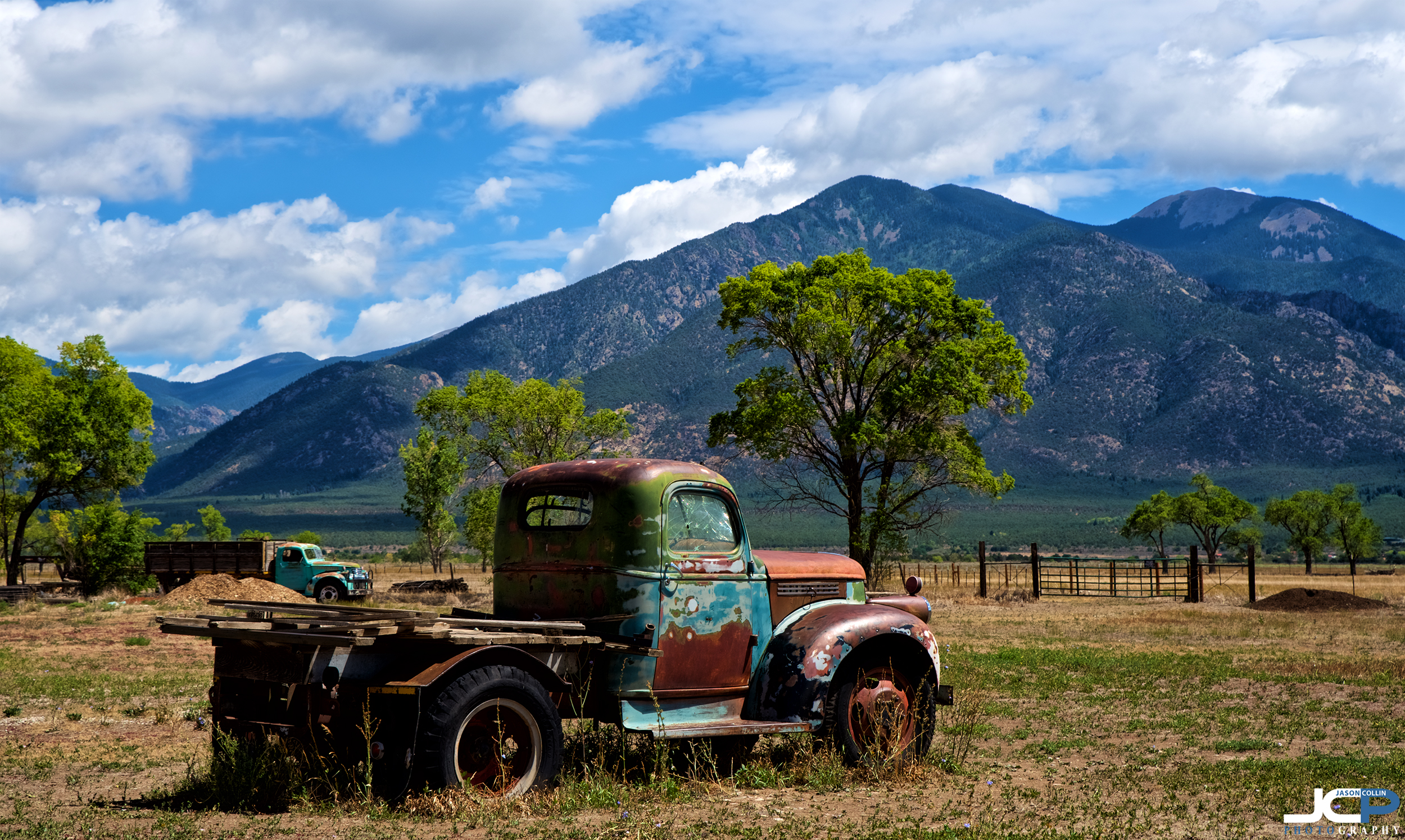 Mountains and forgotten truck in Taos, New Mexico