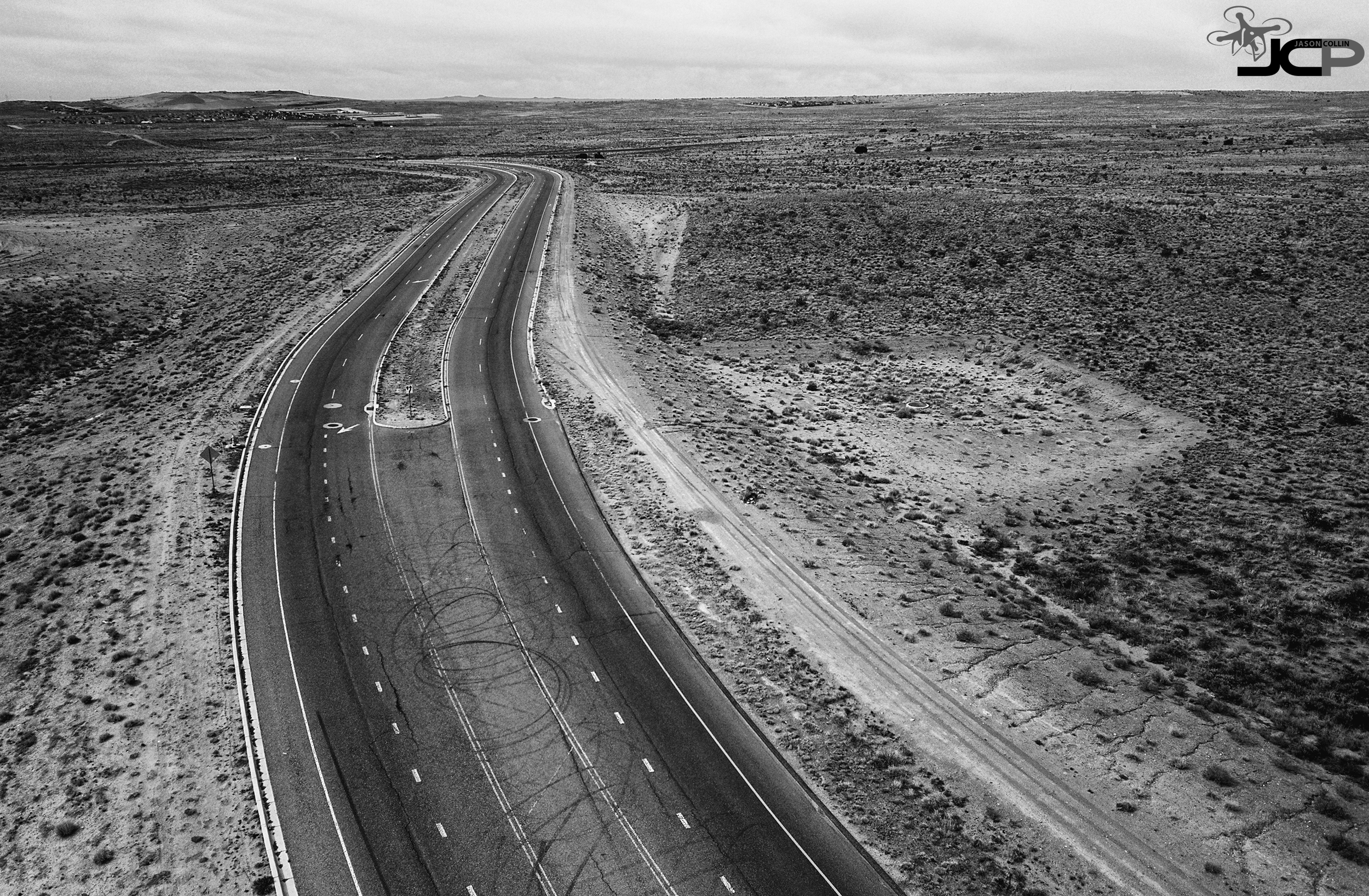 Motorcycles really like to do burnouts on this desert road in New Mexico - drone aerial photo