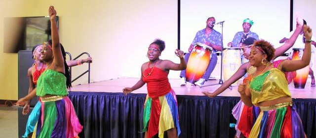 Members of the NSL Dance Ensemble entertain the audience during the Fourth Annual Haitian-Caribbean Book Fair, held at the Caribbean Marketplace at the Little Haiti Cultural Complex over the weekend.  Caitlin Granfield