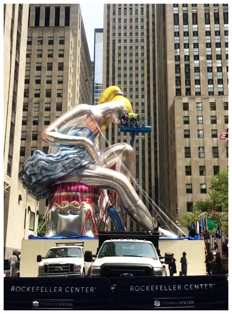 The Rockefeller Center Ballerina by Jeff Koons   I was brought in from the studio, as part of the touch-up crew and went up on the hights there in order to look for details that might need color matching.