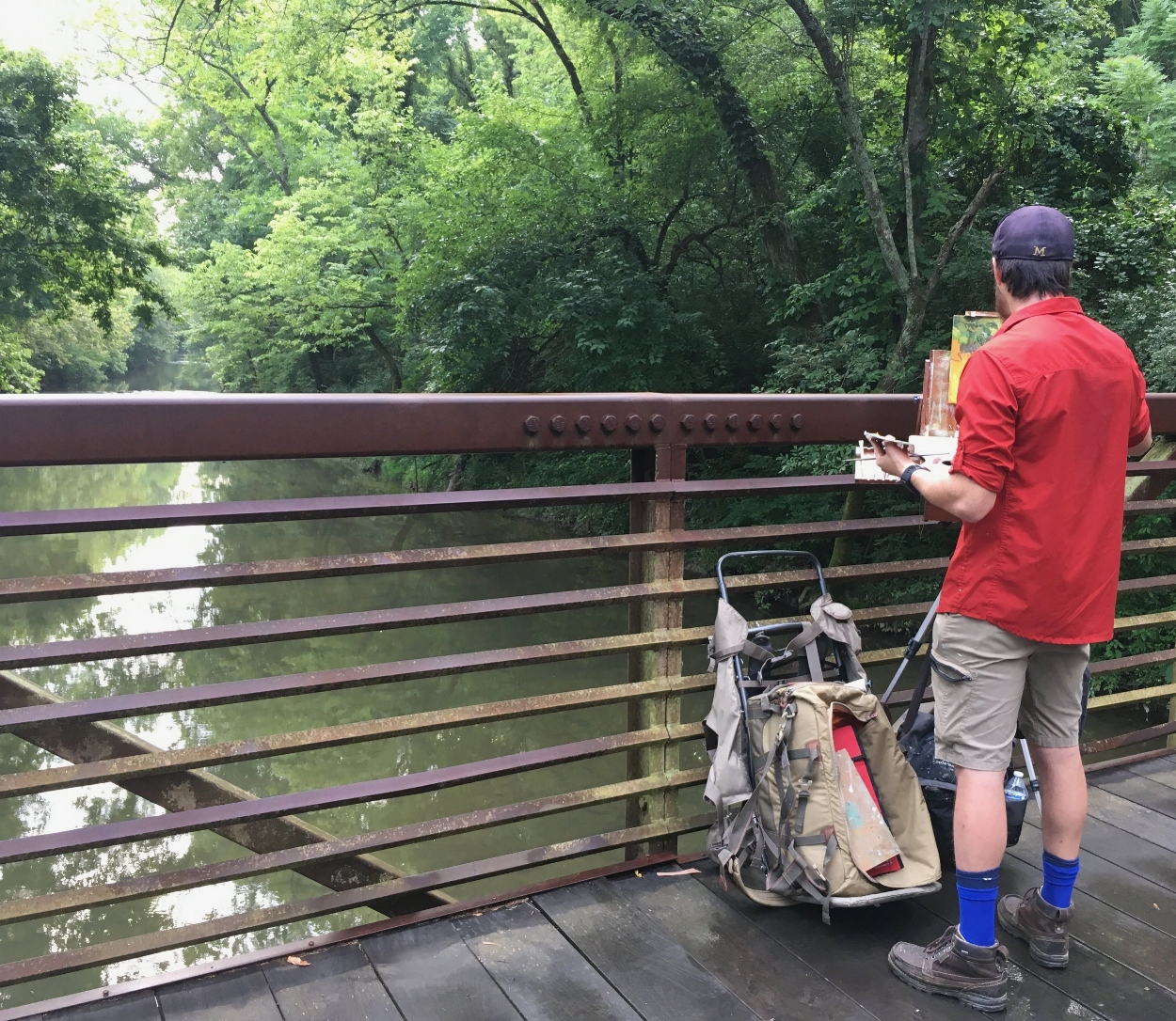 Plein air artist painting at Whites Creek Greenway.