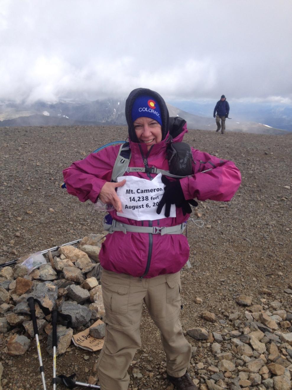 Debbie summiting Mount Cameron, in Colorado.
