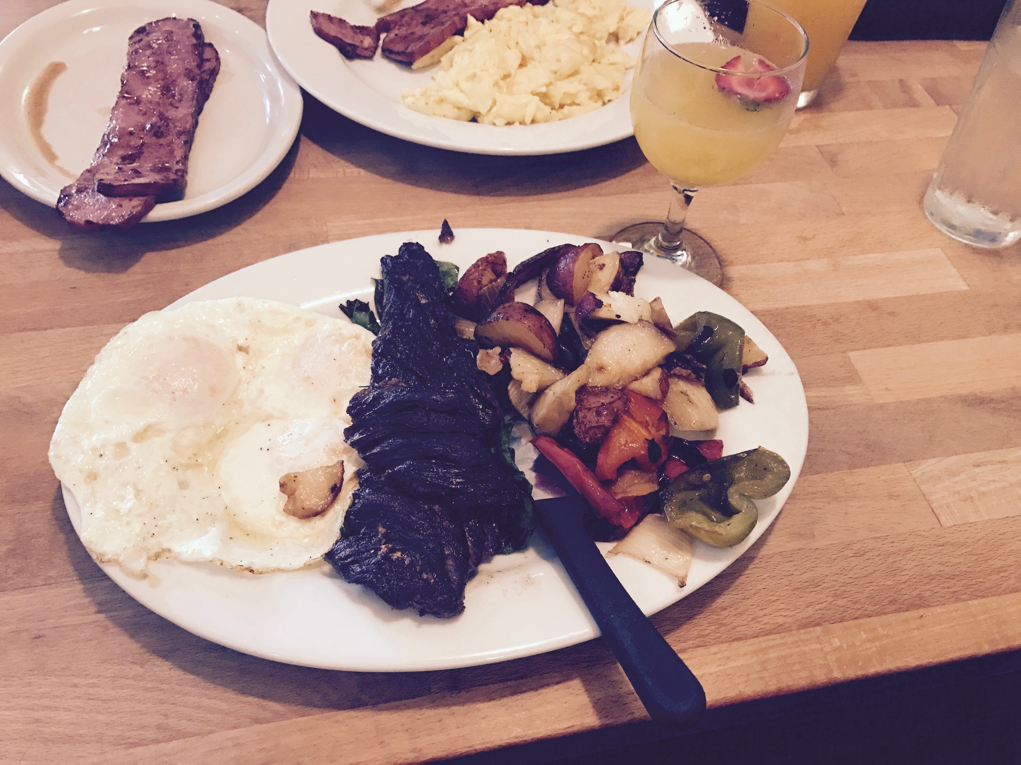 Steak & eggs with a cheeky mimosa