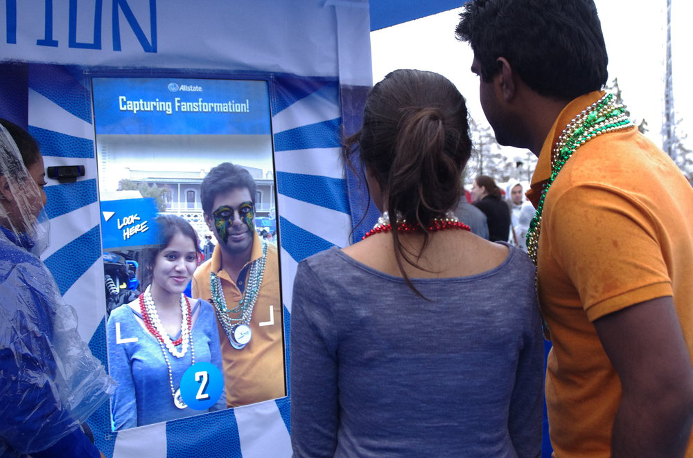Couple posing for Augmented Reality photo booth for Allstate Fansformation