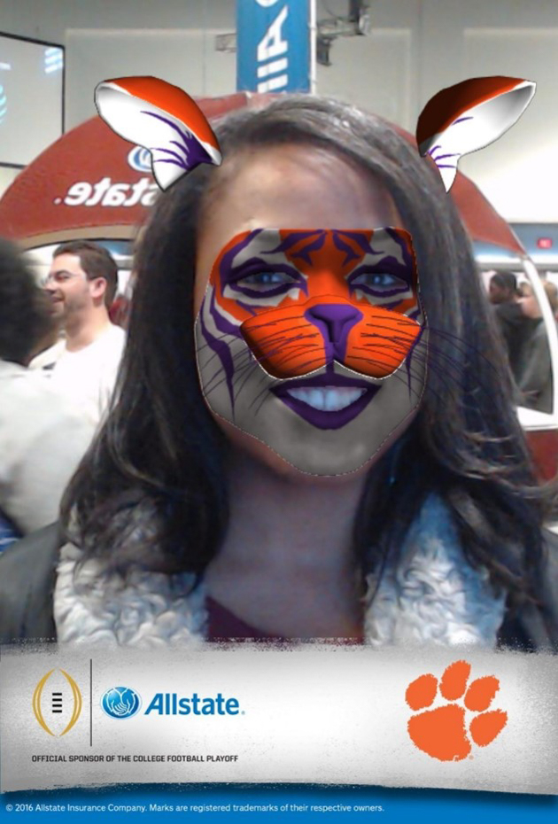 woman football fan with augmented reality tiger face paint