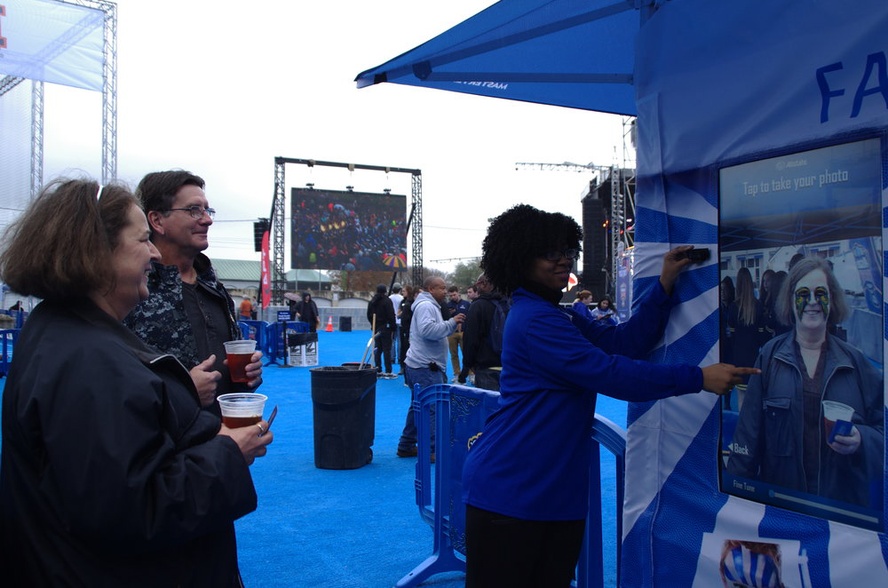 Brand ambassador helping fan with augmented reality photo booth