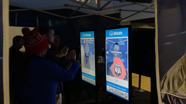 College football fans posing for Allstate AR Photo booth experience