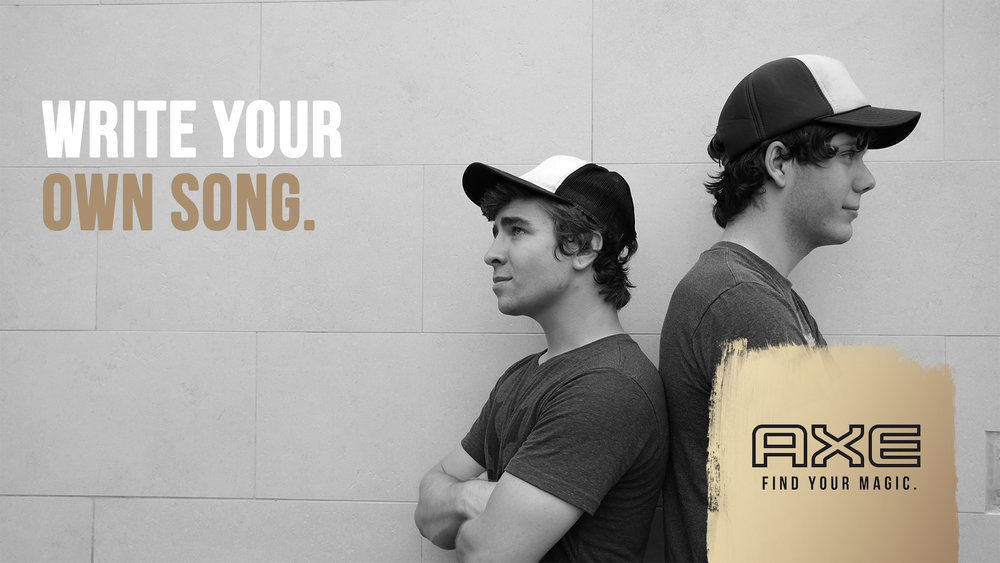 Two men with trucker hats posing back-to-back for the AXE SxSW Digital Billboard with caption: Write your own song