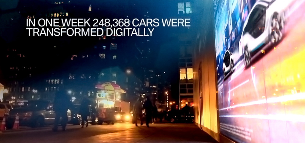 Evening street view of AR window display created by Future Colossal with statistics caption