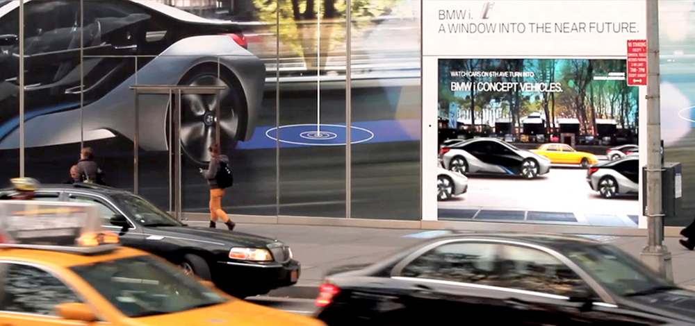 Cars in NYC driving past Augmented Reality window being digitally transformed into BMWs