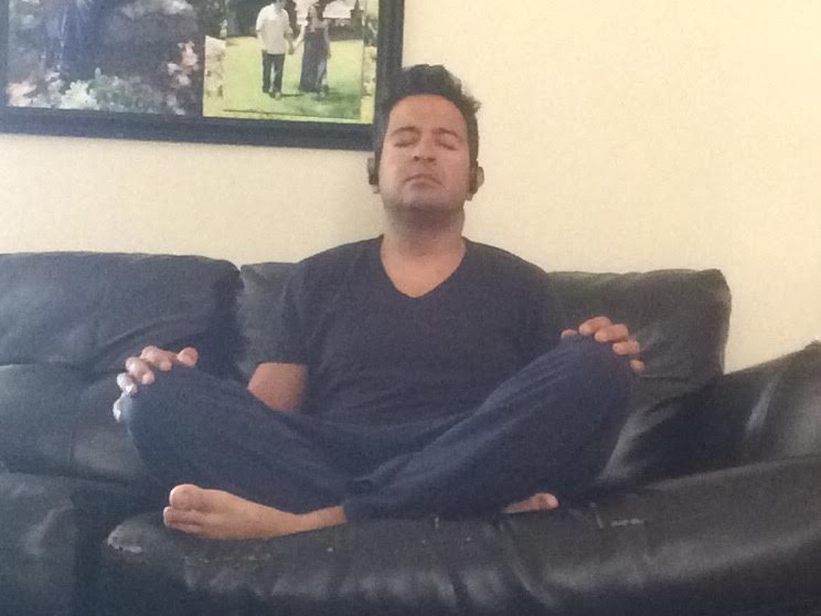 Bad photo, but this is me taking a picture of myself pretending to meditate. Monica will testify that this is accurate and that I should not put my feet on the couch.