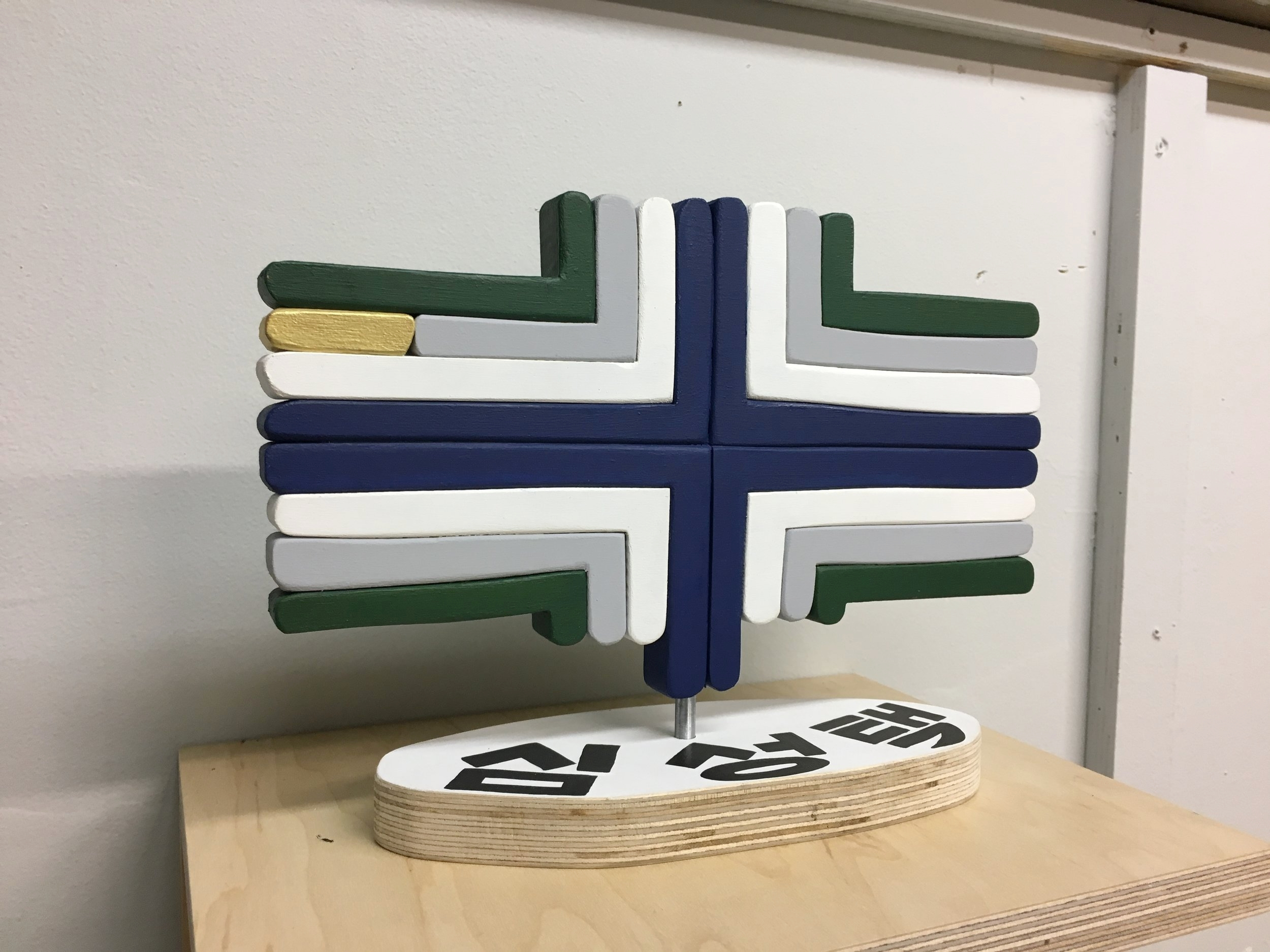 """2018, """"Peace Cross,"""" (A gift for Halmeoni), Paint and wood, text reads """"Sim Sung-Taek"""" a commemoration of my great grandfather who was an intellectual kidnapped during the Korean War. 9""""x11.5""""x3"""""""