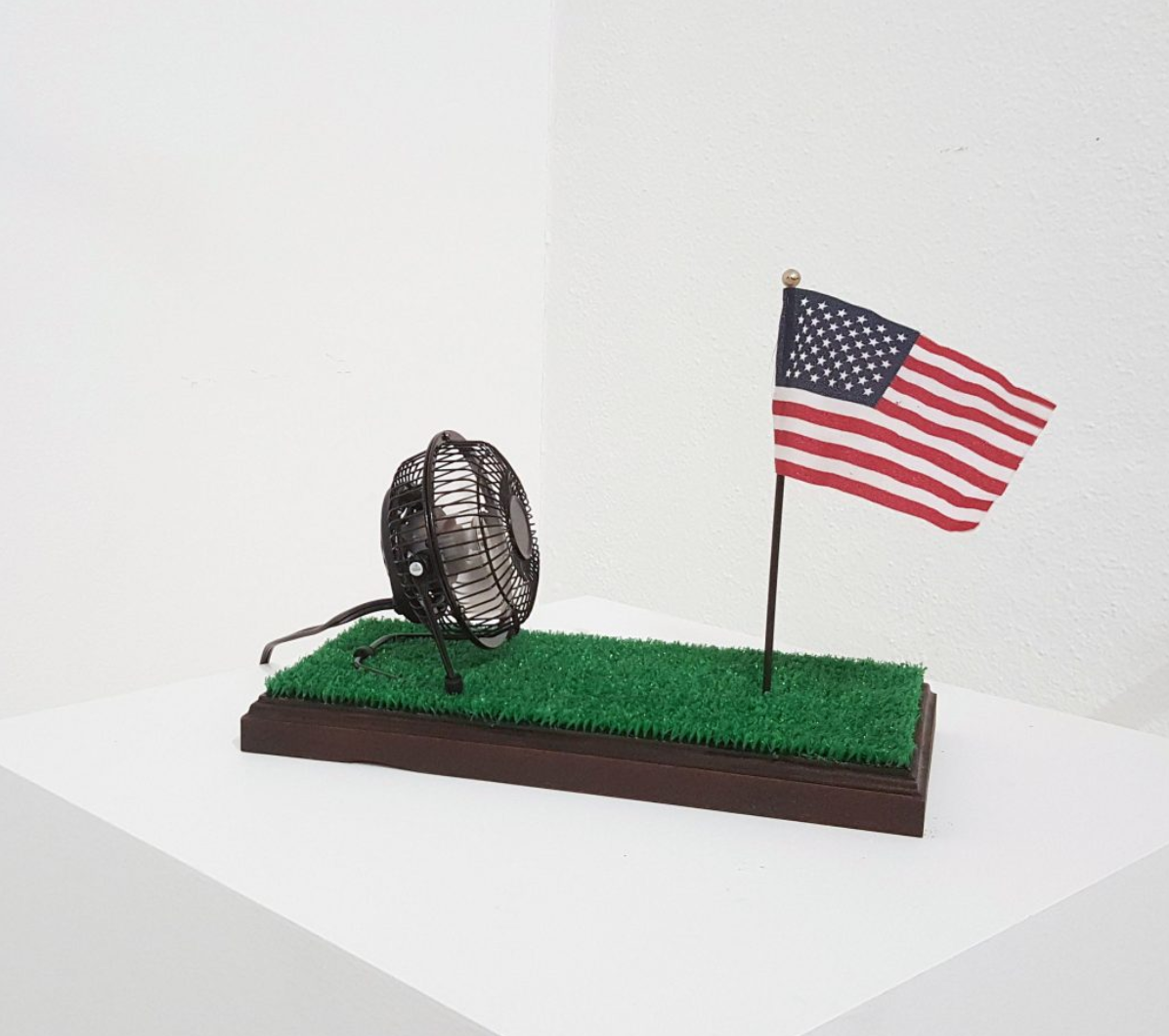 2018, Patriot Kit  Miniature Oak stained pedestal modeled after the Presidential Resolute Desk affixed with artificial lawn, chinese made nail salon fan, and mini flag.