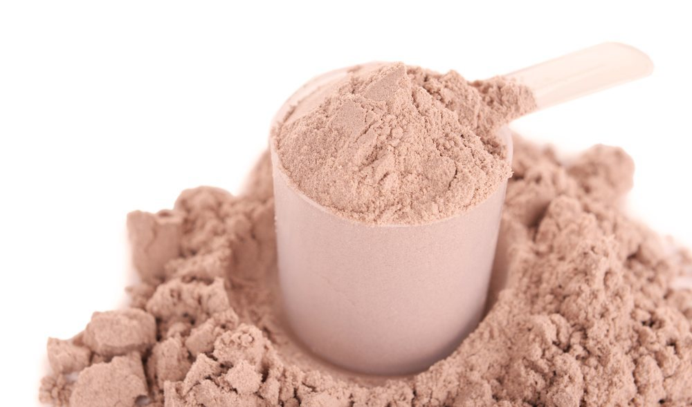 A-scoop-of-whey-protein-powder-on-a-white-background.jpg