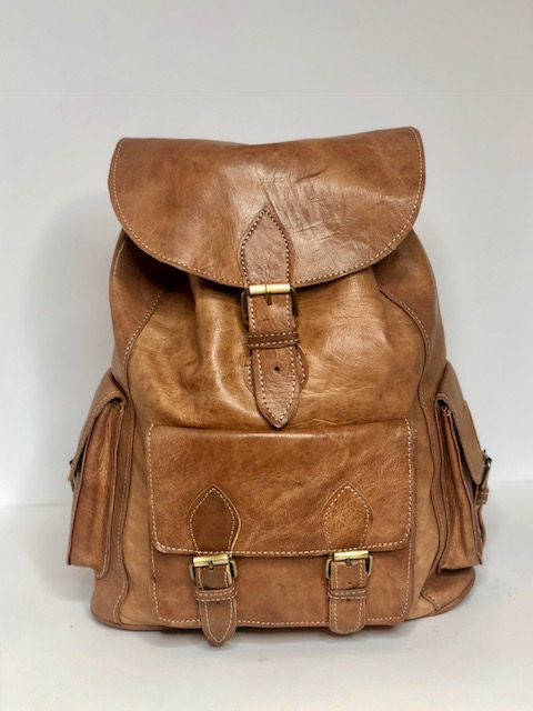 2. The Nomad Backpack from Made Leather Co - From the fanciest of designer brands to the trendiest of graphic designs, backpacks seem to have become a staple item for men. Upgrade his style with The Nomad Backpack from Made Leather Co. Whether he's running errands, headed to a gig or running through the airport, this quality handcrafted classic leather bag is incredibly durable and the perfect choice for a grown man backpack. This natural tan color also goes with everything!