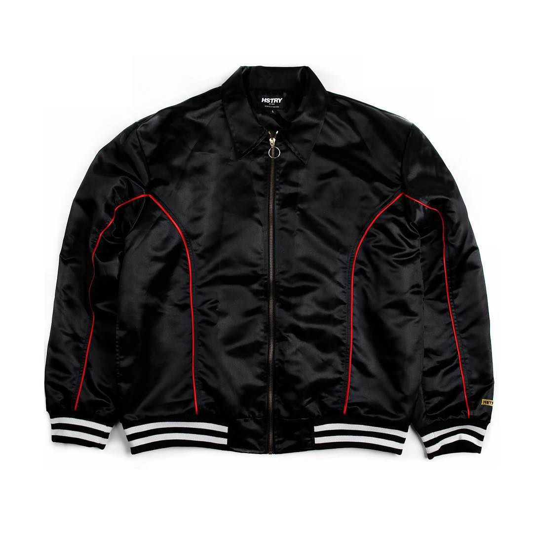 """5. HSTRY X KANI """"Escobar Season"""" Satin Jacket - HSTRY is the apparel brand from hip hop legend Nas inspired by his life experiences, knowledge and inspirations. A classic staple to the male wardrobe is a nice bomber jacket. We are really feeling the Nas and Karl Kani Collaboration. Back in the 90s, Karl Kani set the standards when it came to urban street fashion. There's a bit of nostalgia wrapped into this gift and if he's into hip hop culture beyond the music, this is a must have!"""