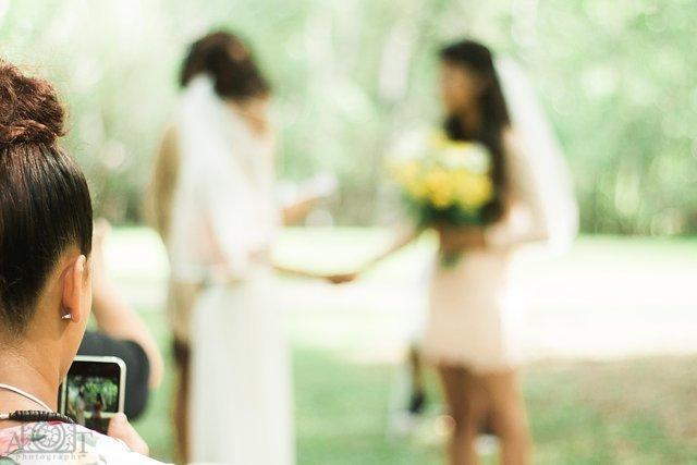 miami-wedding-photographer-samesex-couple-smartphone-ceremony-.jpg