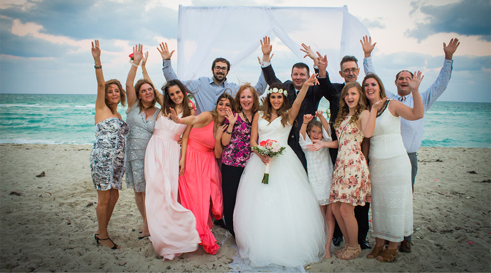 family-wedding-portraits-beach-ceremony-biracial-fun-smiling-goofy-oceanview-arch-pink-bridesmaid-gowns-wedding-dress-los-angeles-wedding-photographer-southern-california-engagement.jpg