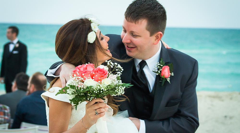 smiling-bride-groom-miami-beach-wedding-ceremony-bouquet-floral-headband-laughing-los-angeles-elopement-engagement-photographer-happy-ocean.jpg