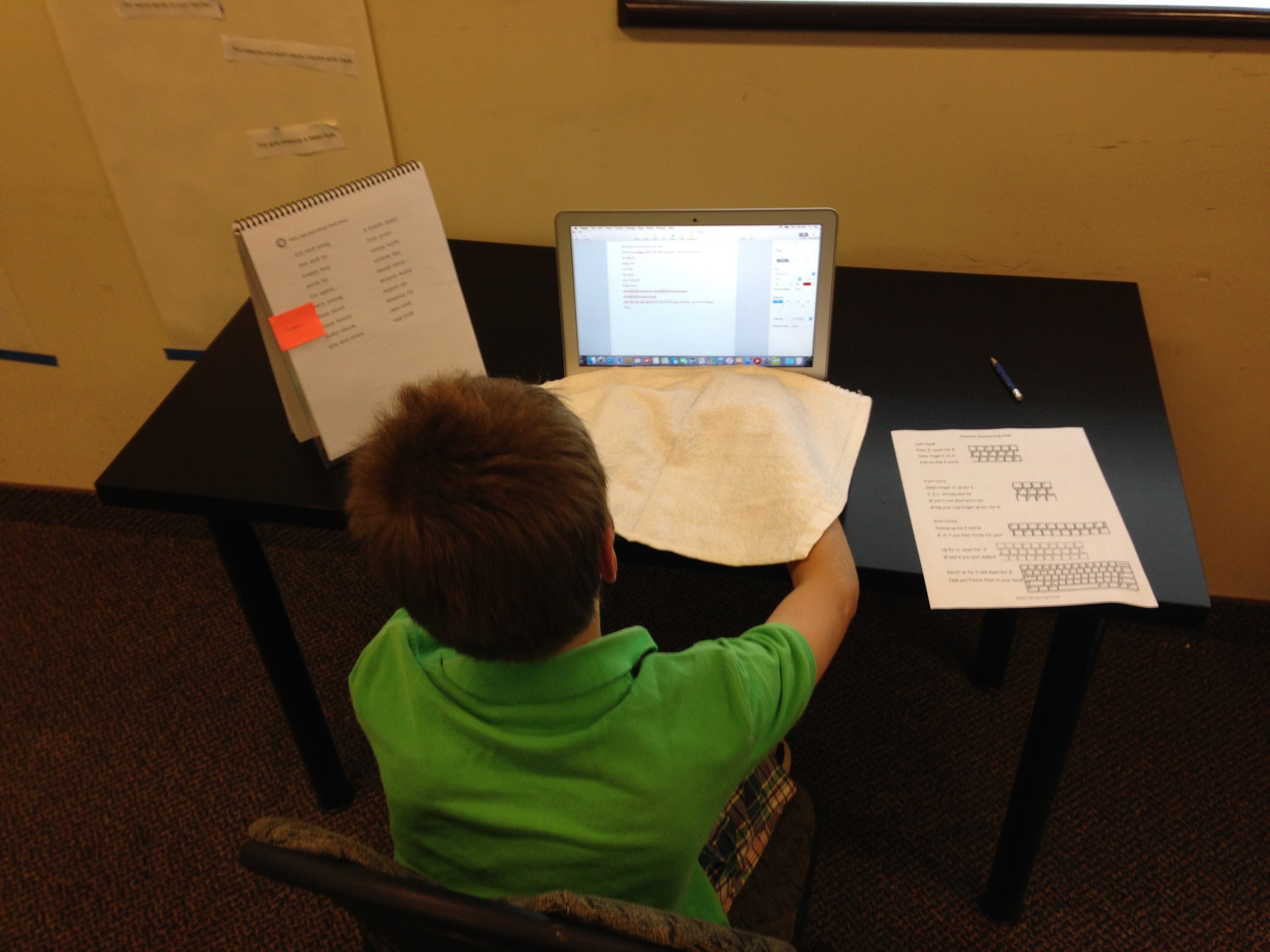 One of our keyboarding students learning how to type with their hands covered.