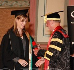 Sarah Willison receiving her MBA