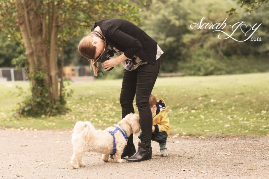 Photographer in Melbourne with dog and baby between legs