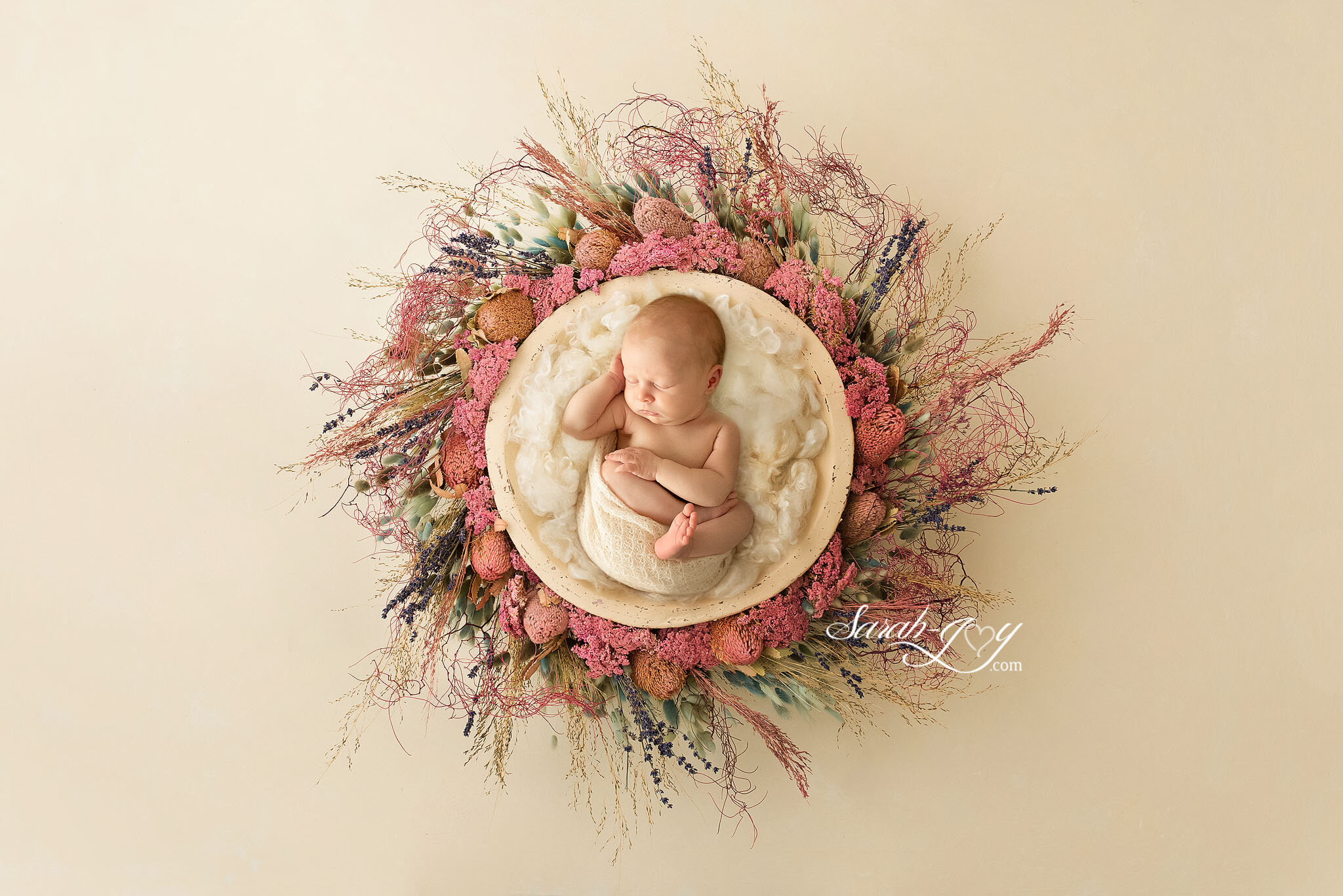 Newborn baby in flower nest