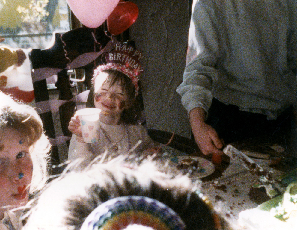 A smug, little birthday brat.