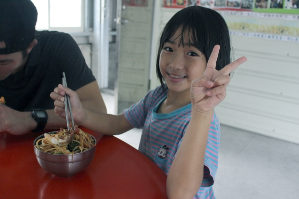 Giving the peace sign is Bao-Ting, enjoying her dinner served by her village's Community Kitchen: the program we're working to improve in Taiwan 12/8/16
