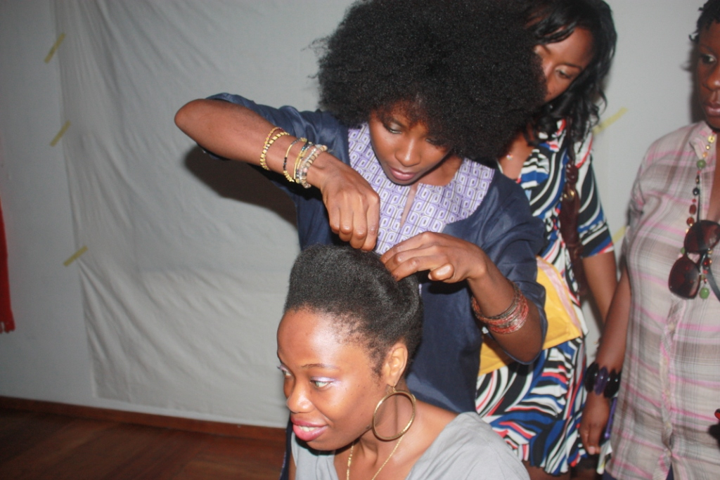 Natmaine styling a volunteer's hair at #NITC1