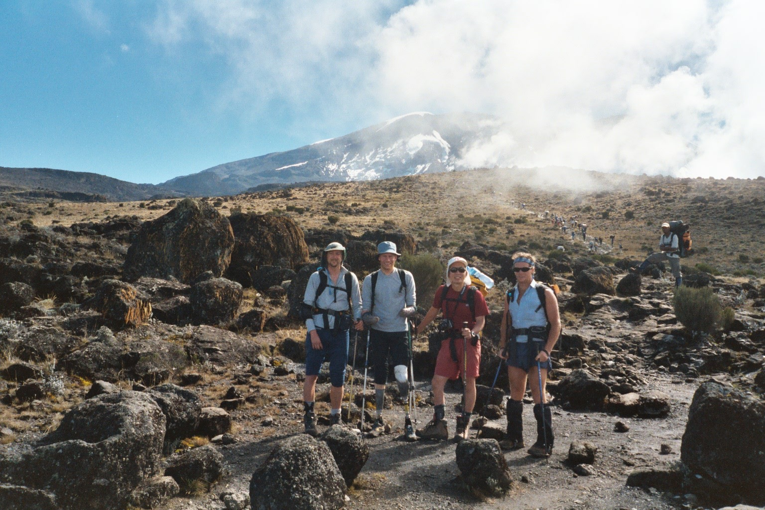 Paul Pritchard (left) with his three other disabled climbing mates with Mount Kilimanjaro behind.