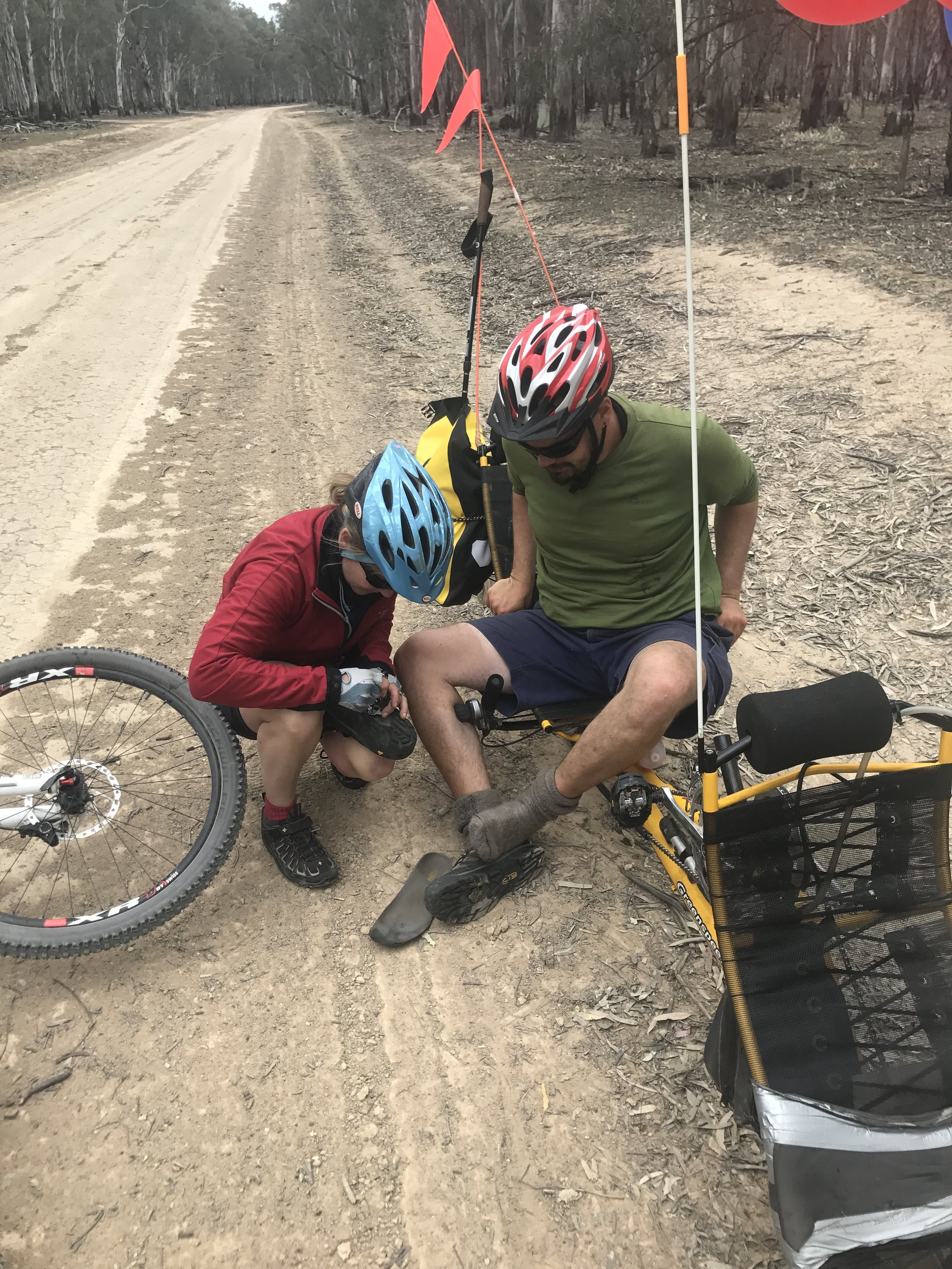 Medic Vonna was worth her weight in gold. Here she helps Duncan fix a cleat in Barmah Forest.