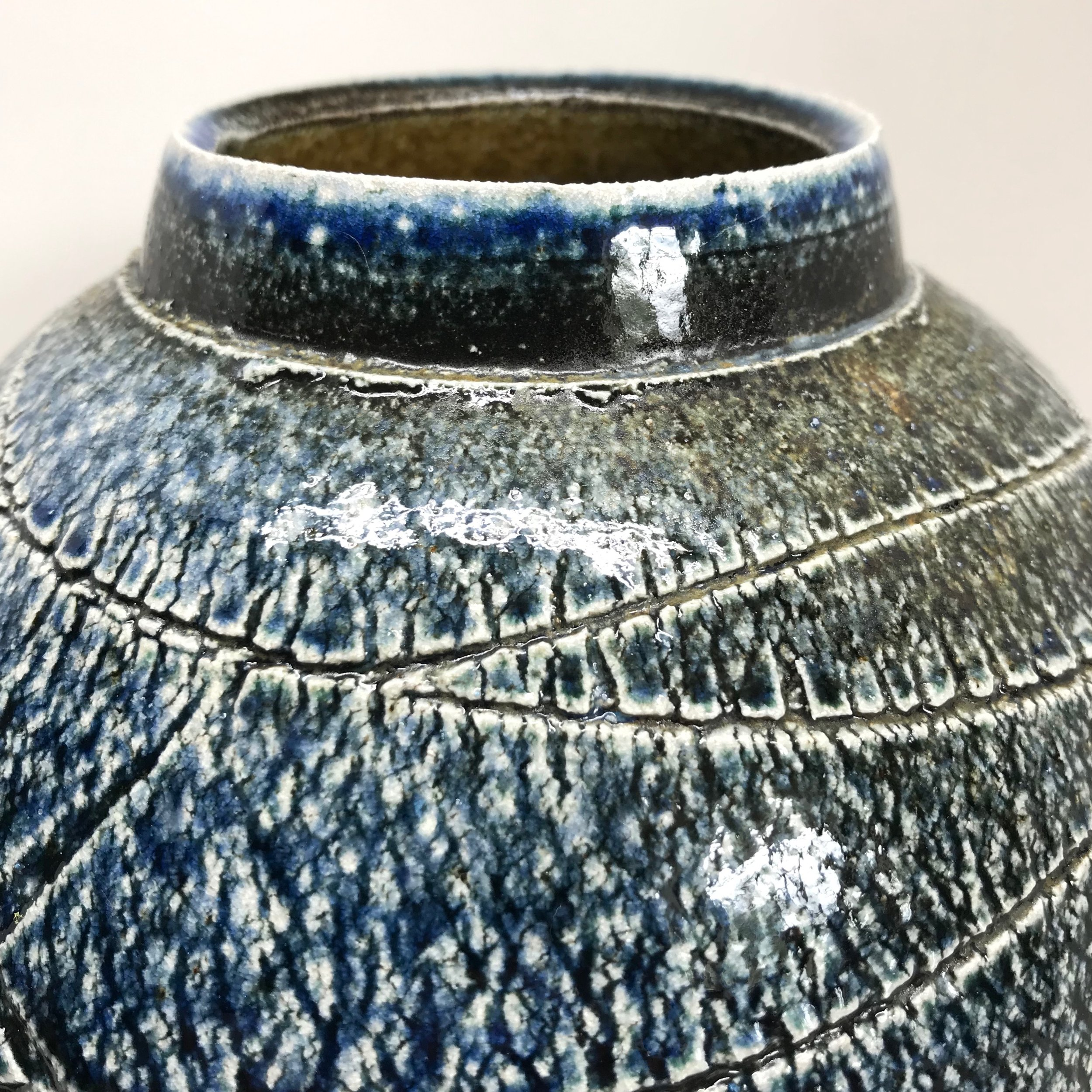 soda fired textured moon jar with wood ash
