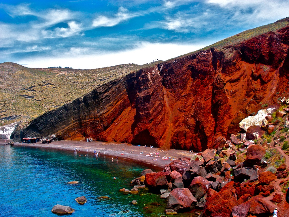 Red Beach   Location: 12 km south west of Fira  Description: Red beach is one of the most beautiful and famous beaches of Santorini. It has black and red volcanic pebbles and hot water.
