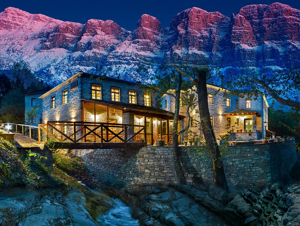 """Papigo     Papigo is one of the 46 villages of the residential, cultural and historical unity of Zagoria. The particular layout, lush vegetation of the region and the unique wilderness of the landscape attract many visitors from Greece and abroad, all year round. Divided into two """"neighborhoods"""", the Big and Small, which is built at the foot of Astraka beneath imposing towers and fabulous Drakolimni, Papigo has a tradition of exceptional hospitality and unique way of maintaining the territorial and cultural organization of local community."""