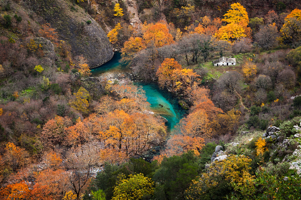Vikos    This traditional Zagori village is built on the edge of the Vikos gorge (altitude 770 m) where the national part of Vikos-Aoos begins. After 30 minutes of hiking along the trail, you arrive at the springs of the Voidomatis river, an ideal place for excursions and mountain sports. It is located 53 km NW of Ioannina.