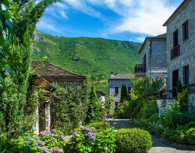 """Aristi    A gorgeous traditional Epirus village, where findings from the Paleolithic period have been discovered. The """"Stamatis Mansion"""" is an exceptional sample of the local architecture. The Monastery of Panagia Spileotisas (16th century), built in a beautiful location near the banks of the Voidomatis river. """"Kastraki"""", with its panoramic view, contains ancient findings. The route at """"Kagelia"""" from the Voidomatis bridge towards Papigo, is charming. It is located 48 km NW of Ioannina."""