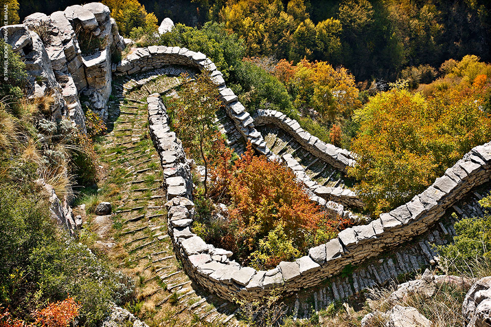 """Vradeto    Skala tou Vradeto, a cobblestone trail from the 18th century is the village's famous landmark. Vradeto is built on a rugged slope (altitude 1,340 m). You can enjoy the wonderful view of the Vikos gorgejust 2 km away from the village, at the """"Beloi"""" location. It is located 51.5 km NW of Ioannina."""