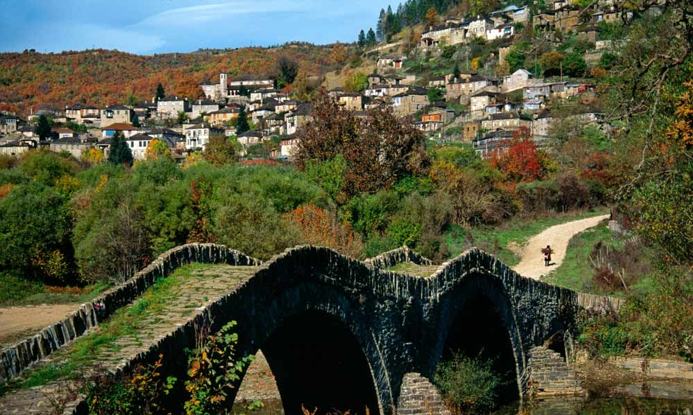 """Kipoi    Village Kipi or Mbagia in Zagori / Zagorochoria is abstains just 38 km from Ioannina city. """"Mpagia"""" is a Slavic word and means """"bath"""". The village was called like that due to the impressive nature and the natural """"pools"""" featured by the rivers around it.  Mpagia  or   Kipi  is the only village that is built amphitheatrically in a slope.  So the travaller can admire all the region just with a glance."""