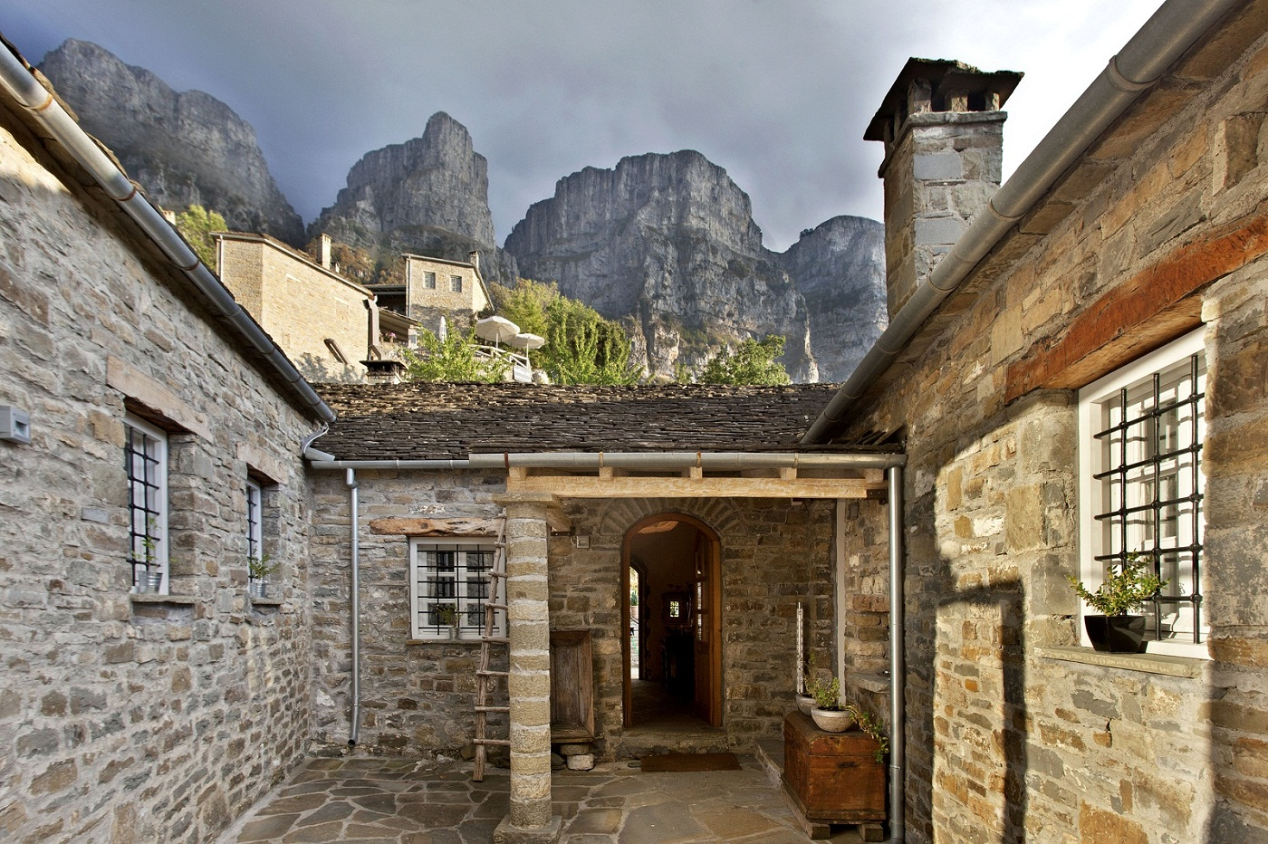 Within the Vikos Gorge, this cosmopolitan hotel is 36 km from Drakolimni Lake and 39 km from the natural phenomena of the Stone Forest.   Laid-back, fashionable rooms with wood furnishings feature minibars, flat-screen TVs, free Wi-Fi and rainfall showers. Upgraded rooms offer fireplaces or balconies, while suites add Jacuzzis. Room service is available.  Complimentary breakfast is served in a refined restaurant with views of the Gorge. There's also a posh spa with an indoor pool, a steam room and a sauna.
