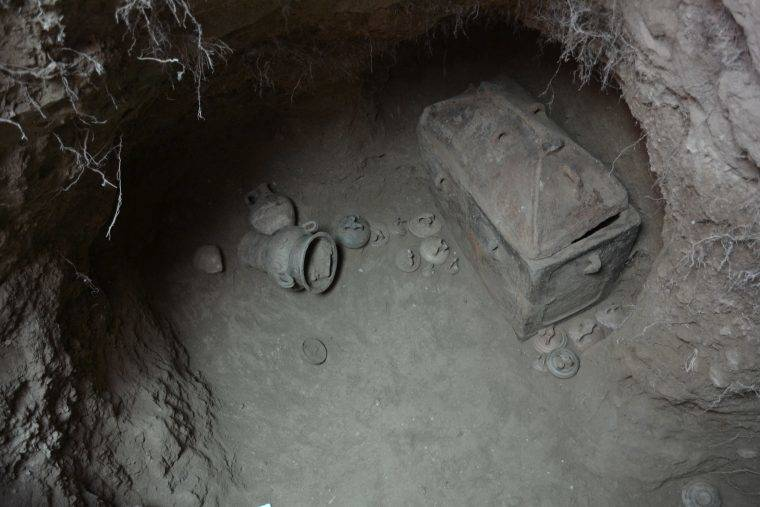 The eight-foot deep pit contained two coffins and several artifacts.