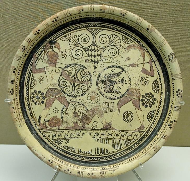 Fig.12: Rhodian Middle Wild Goat style plate depicting Menelaus and Hector fighting over the body of Euphorbus. Author: Jastrow 2006.