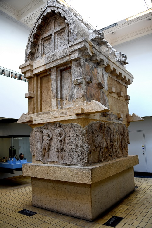 This is a limestone tomb with gabled roof. It was decorated with reliefs on its four sides and inscribed with Lycian inscriptions. It was made in Lycia; found in Xanthus. Greek Period, circa 375-362 BCE.