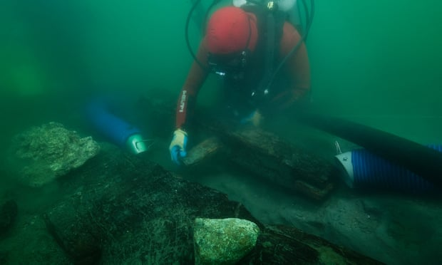 An archaeologist inspects the keel of a shipwreck discovered in the waters around the sunken port-city of Thonis-Heracleion. Photograph: Christoph Gerigk/Franck Goddio/Hilti Foundation