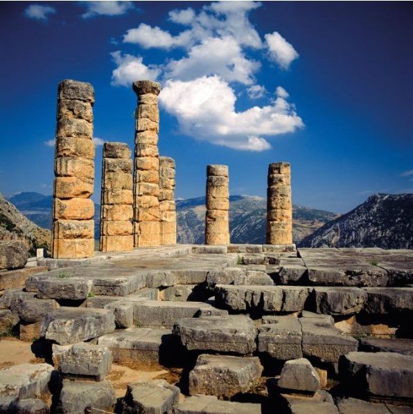 ASKING THE ORACLE   All that remains of the Temple of Apollo, situated on the third terrace, are six broken Doric columns. Here the Pythia would deliver prophecies to those who came to consult the god.   PHOTOGRAPH BY JOHANNA HUBER/FOTOTECA 9X12