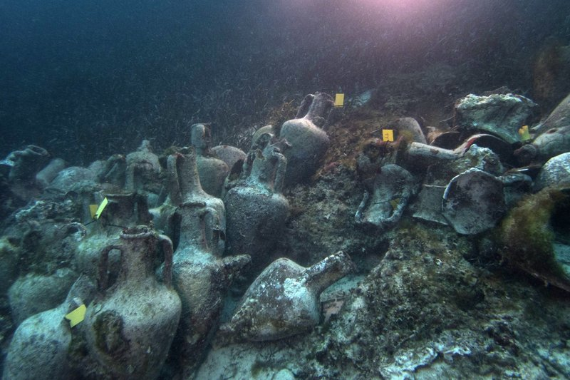 In this photo taken on Sunday, April 7, 2019, ancient amphoras lie at the bottom of the sea from a 5th Century B.C. shipwreck in Greece, near the coast of Peristera, Greece. (AP Photo/Elena Becatoros)